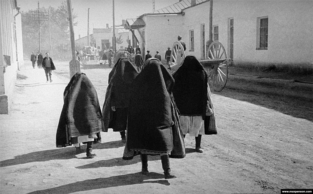 Women in burqas on the streets of Tashkent. Scenes like this became increasingly rare under Soviet rule.