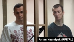 Ukrainian film director Oleh Sentsov (left) and co-defendant Oleksandr Kolchenko appear in court on July 21.