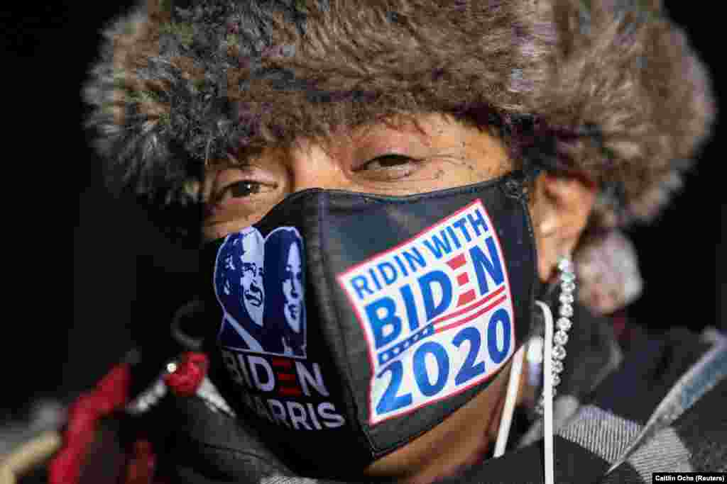 """Cat Keith wears a """"Ridin with Biden 2020"""" face mask on Election Day, in Brooklyn, New York City, New York, U.S., November 3, 2020."""