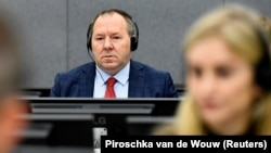 Hysni Gucati appears in court before the Kosovo Specialist Chambers in The Hague on October 7.