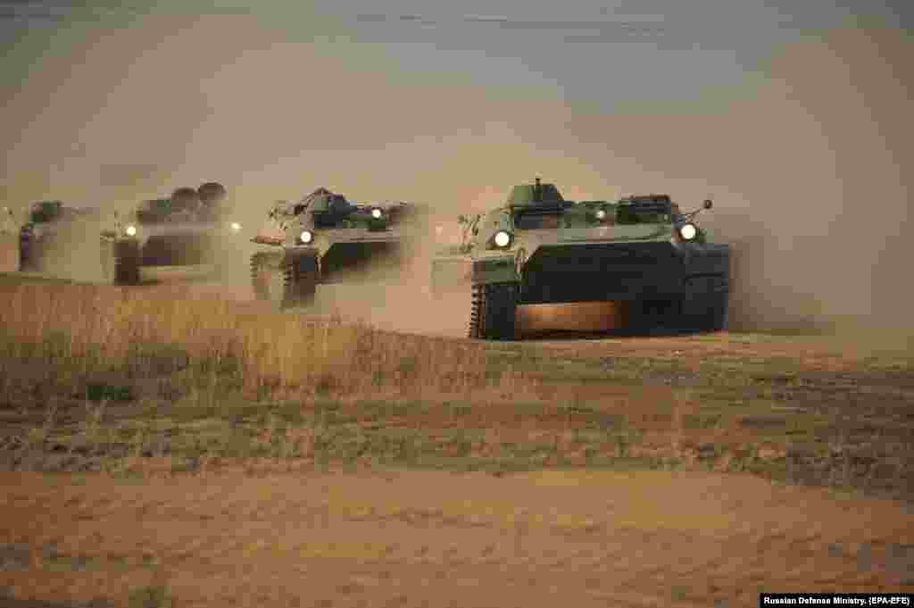 Armored vehicles grind through a Kazakh desert on September 16. The war games will involve troops from Russia, China, India, and Pakistan, along with the Central Asian states of Kazakhstan, Uzbekistan, Kyrgyzstan, and Tajikistan.