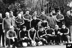 The Soviet national team gathers for a workout in an unidentified place in Russia in November 1969. Yevgeny Lochev is third from left, kneeling.