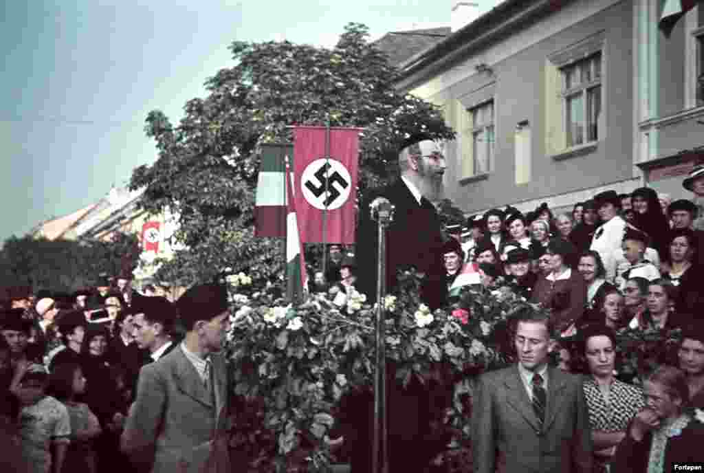 A rabbi speaks in front of a swastika in the Transylvanian town of Bistrita as Hungarian troops arrive in 1940. This striking image from Romania, along with the other photos in this gallery, are from the Fortepan photo archive. The collection of mostly amateur photos captures life in Central Europe through the 20th century.