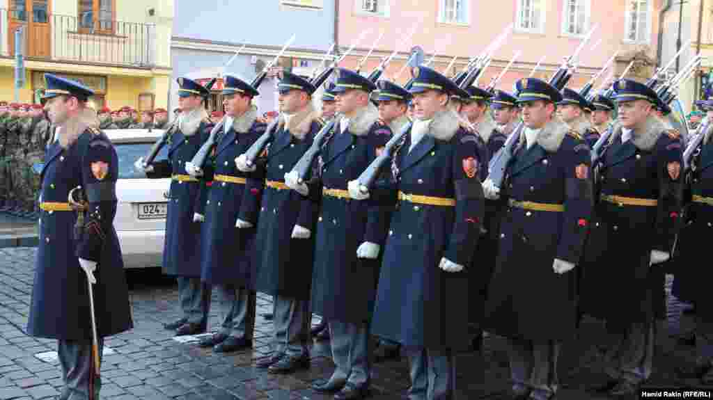 Palace guards prepare to meet the procession as the hearse carrying the former president Vaclav Havel arrives at Prague Castle.
