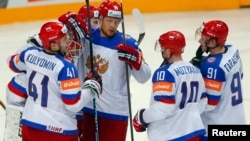 Russian players celebrate defeating the United States in their Ice Hockey World Championship semifinal game in Prague.