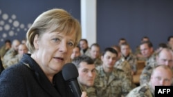German Chancellor Angela Merkel addresses soldiers during a visit to Kunduz last year.