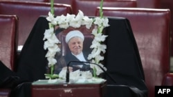 An empty seat, with a photo bearing a portrait of former president Akbar Hashemi Rafsanjani, is seen during a session of Iran's Assembly of Experts in Tehran, March 7, 2017