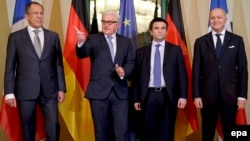 German Foreign Minister Frank-Walter Steinmeier gestures as he is flanked by Russian Foreign Minister Sergei Lavrov (far left), French Foreign Minister Laurent Fabius (right), and Ukrainian Foreign Minister Pavlo Klimkin (second from right) at the start of talks in Berlin on January 12.