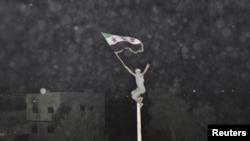 Участник демонстрации в Дамаске