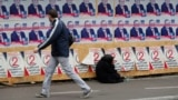 A man looks at campaign posters for opposition candidate Shalva Natelashvili in Tbilisi on October 22.