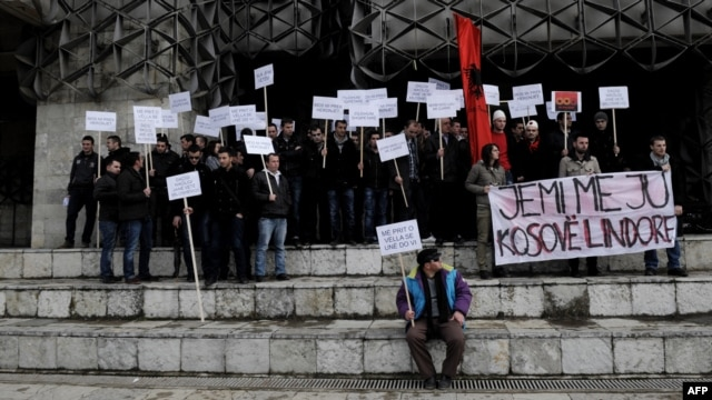 Ethnic Albanians take part in a protest in Pristina on January 16