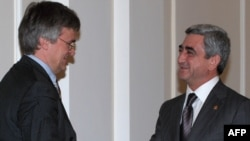 President Serzh Sarkisian (right) greets EU envoy Peter Semneby in Yerevan.