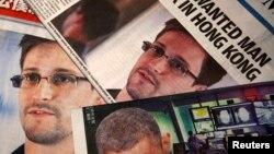 Һоң-Коңга качкан дип исәпләнүче Эдвард Сноуден газетларның беренче битендә