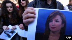 Students of Irbil's College of Journalism hold portraits of Shifa Gardi, a journalist for the network Rudaw who was killed while covering the Mosul offensive, during a memorial ceremony in Irbil on February 26.