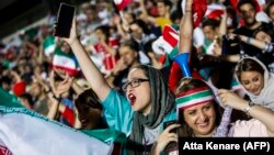Iranian female soccer supporters were given a rare opportunity to cheer their team on at a special live transmission in Tehran of their country's World Cup game with Spain on June 20.