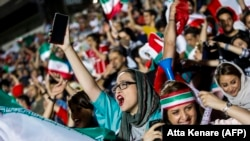 Iranian women cheer their World Cup soccer team at Tehran's Azadi Stadium on June 20.