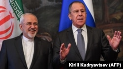 A file photo of Russian Foreign Minister Sergei Lavrov (right) with his Iranian counterpart Mohammad Javad Zarif. Moscow stands poised to capitalize on the probable withdrawal of Western companies from deals with Tehran when the U.S. reintroduces economic sanctions.