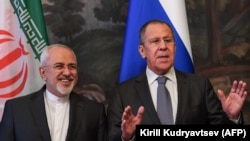Russian Foreign Minister Sergei Lavrov (R) gestures next to his Iranian counterpart Mohammad Javad Zarif ahead of a meeting of foreign ministers of the Caspian Sea littoral states in Moscow, December 05, 2017