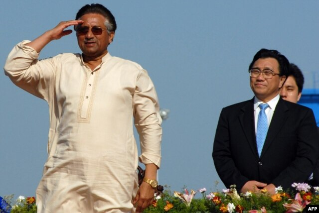 Then-Pakistani President Pervez Musharraf (left) salutes as China's Minister for Communication Li Shenglin (right) looks on during the inauguration of the Gwadar port on March 20, 2007.