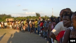 People line up to receive food at a UN distribution center last week.