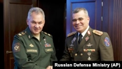 RUSSIA -- Russian Defense Minister Sergei Shoigu, left, and Venezuelan Minister of Defense Vladimir Padrino Lopez pose for a photo prior to their talks in Moscow, August 15, 201