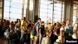 Российские и британские туристы в аэропорту Шарм-эш-Шейха