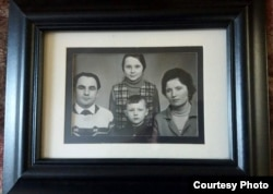 An old family photograph of Volodomyr, his older sister Natalia, and their parents.