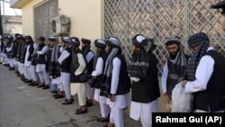 Prisoners line up at the Pul-e Charkhi prison after their release in Kabul on January 11.