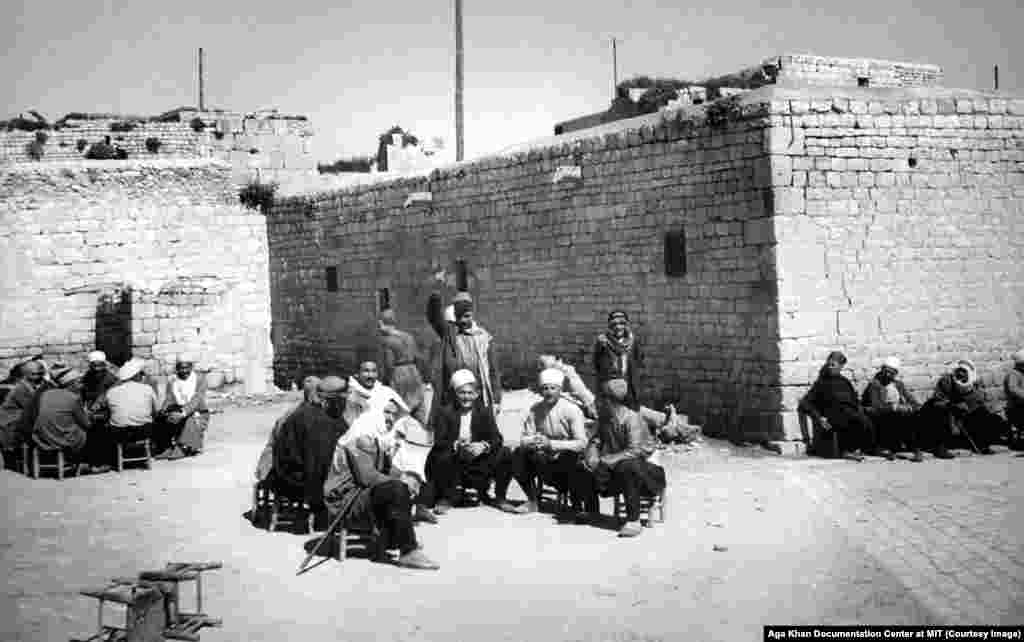 "An undated street scene in Aleppo. For most of its history, the ancient trading city was a beacon of relative tolerance. T.E. Lawrence wrote that in Aleppo ""more fellowship should rule between Christian and Mohammedan, Armenian, Arab, Turk, Kurd and Jew than in perhaps any other great city of the Ottoman Empire."" When the Ottoman Empire collapsed after World War I, that fellowship began to fray."