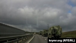 A convoy of Russian military equipment is seen on the move in Crimea on March 24.