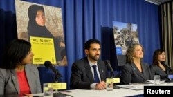 U.S. -- Amnesty International's (AI) Pakistan Researcher Mustafa Qadri (2nd L) makes remarks at a press briefing in Washington October 22, 2013