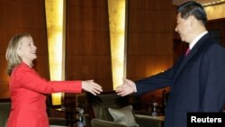 A photo of Chinese Vice President Xi Jinping meeting with U.S. Secretary of State Hillary Clinton in Beijing in May. Xi's sudden cancellation of more recent meetings set the rumor mill spinning.