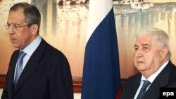 Министр иностранных дел Сирии Валид аль-Муаллем (справа)