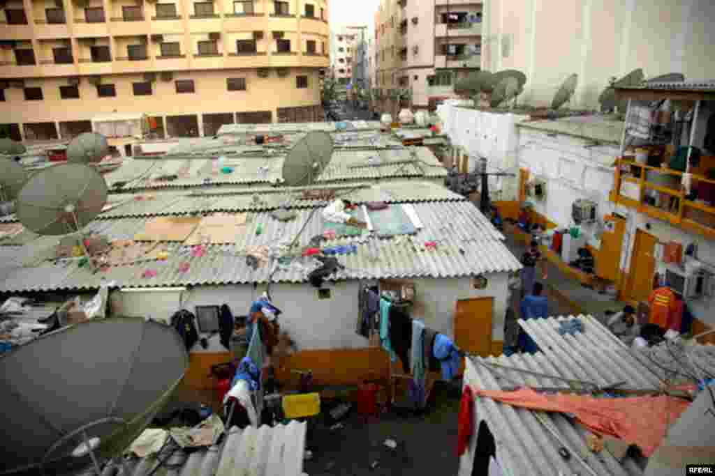 Other workers have been squeezed out of their rooms by overcrowding and sleep on the roofs of their buildings.