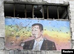 Hələb şəhərində yerləşən Polis Akademiyasında prezidet Bashar Assadın rəsmi