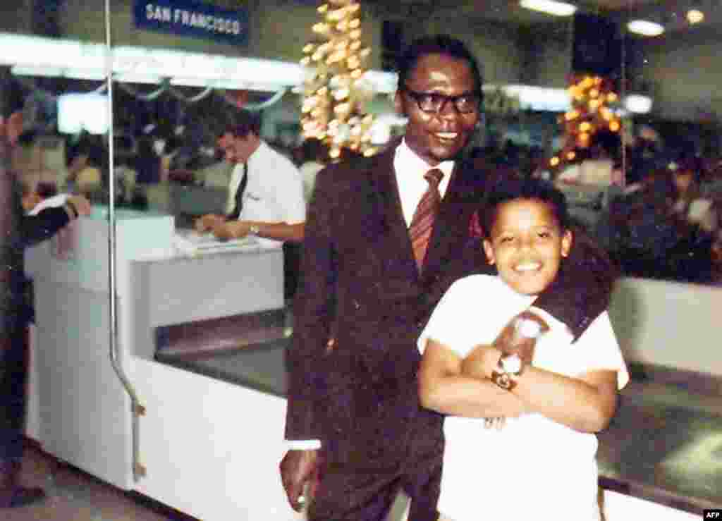 A preteen Barack Obama -- the future U.S. president -- with his Kenyan father in Hawaii in 1972