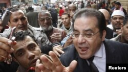 Opposition politician Ayman Nour speaks during a rally on Cairo's Tahrir Square on February 1.