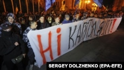 """No capitulation!"": Far-right activists protest against Ukraine agreeing to the so-called Steinmeier Formula near of the president's office in Kyiv on October 1."