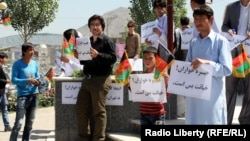 Young people demonstrate against Khomeini in Kabul on May 30.
