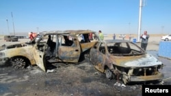 People gather at the site of a car-bomb attack in the town of Tuz Khurmatu, north of Baghdad, on May 5.