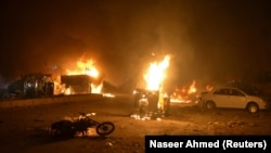 Vehicles on fire after a roadside bomb attack in Quetta that killed at least 15 soldiers and civilians on August 12.