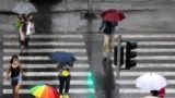 Macedonia - Rain in Skopje, people with umbrellas - 5Aug2020