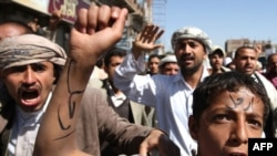 "A young Yemeni protester with the word ""Leave"" written across his forehead at an antigovernment demonstration in the capital, Sanaa, on February 23"