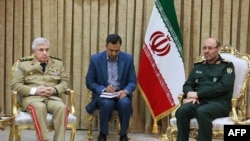 Former Iranian Defense Minister Hossein Dehghan, (currently Khamenei's advisor) meeting with Syrian chief of staff General Ali Abdullah Ayoub (L) in Tehran, May 2, 2017