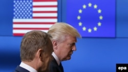 U.S. President Donald Trump (R) walks with the President of the European Council Donald Tusk in Brussels, May 25, 2017