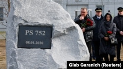 UKRAINE -- People attend a foundation stone laying ceremony for a future memorial site to the people killed in a plane shot down in Iran in January, at the Boryspil International Airport outside Kyiv, February, 17, 2020