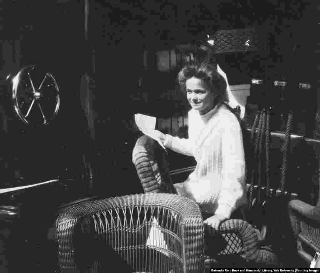 Olga Romanov in a wicker chair aboard the Standart