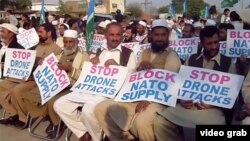 Members of the Islamist party Jamat-e Islami protest in Peshawar against U.S. drone strikes and call for a blockade of NATO supplies on November 8.