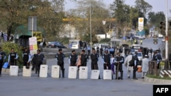 Riot police cordon off a street leading to the U.S. embassy in Islamabad. (file photo)