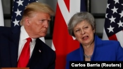 U.S. President Donald Trump and Britain's Prime Minister Theresa May hold a joint news conference in London on June 4.